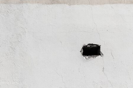 Deep hole in wall - concept image. Hole in wall.