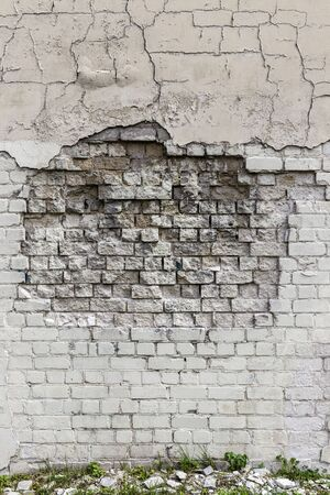 Deep crack in old brick wall - concept image. Broken wall.