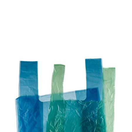 Blue and green plastic shopping bags isolated on white background.