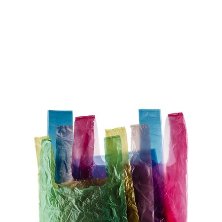 Five plastic shopping bags isolated on white background.