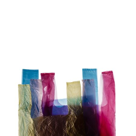 Four plastic shopping bags isolated on white background.
