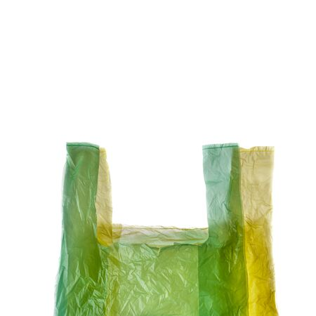 Yellow and green plastic shopping bags isolated on white background.