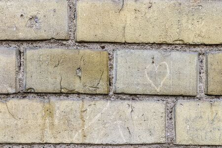 Old brick wall - concept image. Wall as background. Heart.