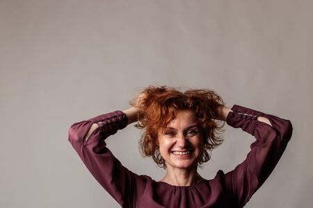 Red-haired woman. Red Hair woman on gray background. Happy woman, good vibes.