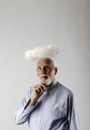 Old man and cloud. Old man is dreaming or thinking about something. Looking up.