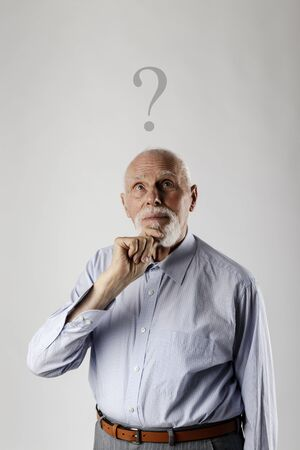 Old man is full of doubts and hesitation. Old man and question mark above head. Reklamní fotografie