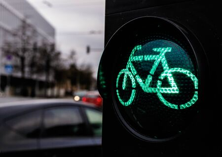 Traffic light for cyclists. Green light for bycicle lane on a traffic light. Traffic light in green for cyclists, with the figure of a cyclist.