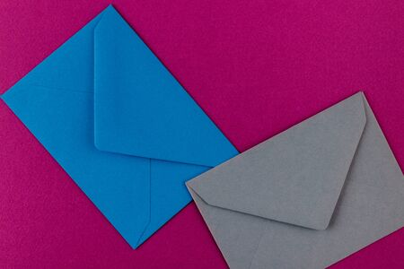 Colorful envelopes on a purple background. Mail envelopes on the table.