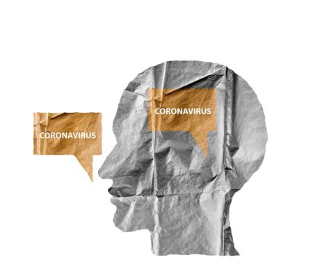 Crumpled paper shaped as a human head and talk balloon on white. Paper human head with Coronavirus text. COVID-19 crisis concept. Virus everywhere. 版權商用圖片