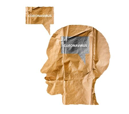 Crumpled paper shaped as a human head and talk balloon on white. Paper human head with Coronavirus text. COVID-19 crisis concept. Virus everywhere.