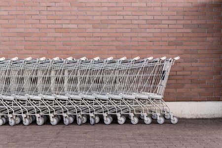 Trolleys. Row of shopping trolleys or carts near supermarket. Stock Photo
