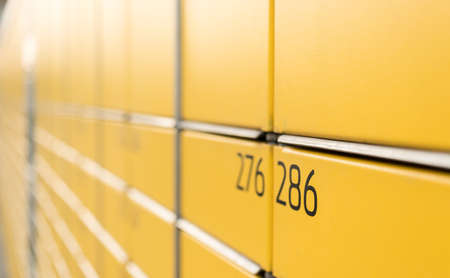 Post office box. Yellow post box for rentals. Post box lockers for parcels that the recipient can pick up there. Pack station. Standard-Bild