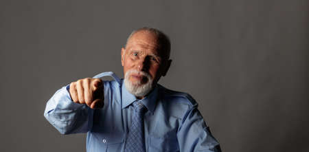 Old man pointing his finger at you. Accusation. Hey you!