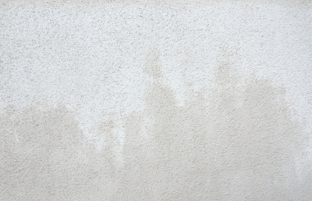 Rough gray and white wall
