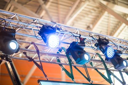 floodlit: Light tower lit at a stadium during nightime. Stock Photo