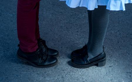 69e0d7ec659 Valentines Day legs man and woman couple pants asphalt shoes sandals  manicure. Black elegant lether