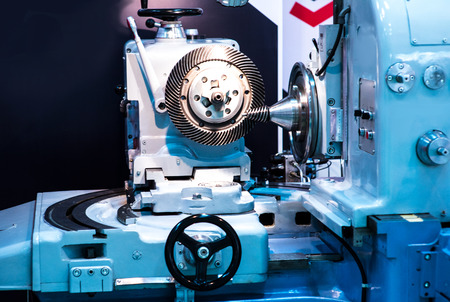 poquito: Metalworking CNC milling machine. Cutting metal modern processing technology. Small depth of field. Warning - authentic shooting in challenging conditions. A little bit grain and maybe blurred.