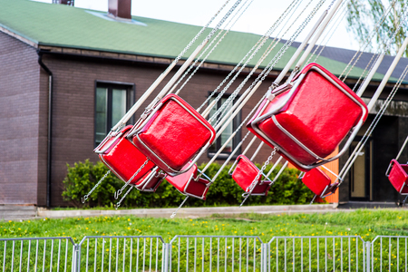 chain swing ride: Flying Swing in Theme Park Stock Photo