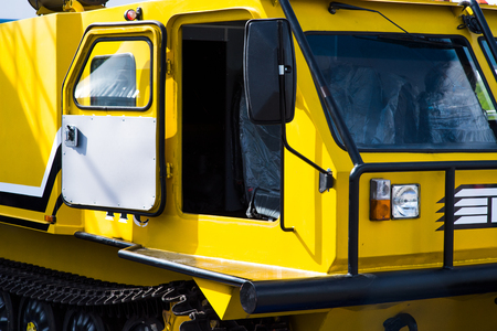yellow buldozer in a construction site with open cabine