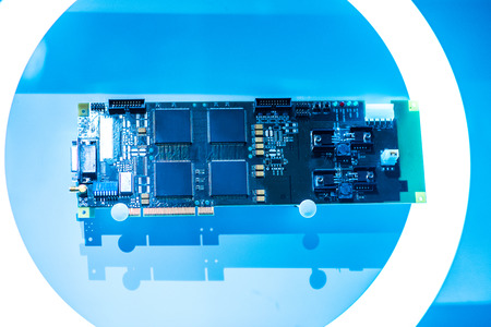 Circuit board. Electronic computer hardware technology. Motherboard digital chip. Tech science background. Integrated communication processor. Information engineering component. Blue color. Stock Photo