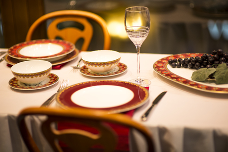 Empty plates and glasses set in restaurant Stock Photo