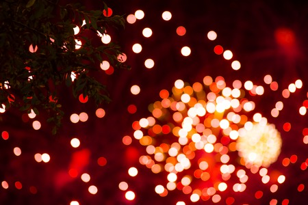 Abstract defocused red glittering shine bulbs lighting bokeh on blurred green background in colorful warm tone for Christmas and New Year conceptsparkling golden Stockfoto - 108740966