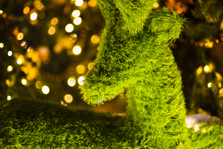 Green deer. Abstract christmas background, light blur creating nice bokeh, red white and orange. Stok Fotoğraf