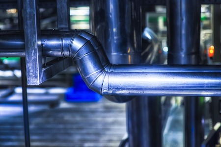 Stainless steel pipes in the factory. Construction on food production, Abstract industry background. Stok Fotoğraf