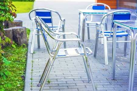 Empty chairs in outdoor cafe or restaurant on summer day