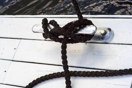 Marina bollard bitt at jetty for boats, ships and yachts mooring knecht cross