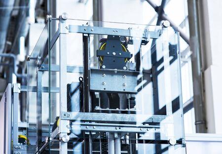 Elevator Installation, Lift Technician Installing a Modern Elevator Foto de archivo