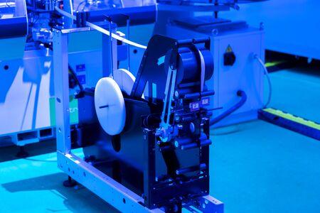 Conveyor belt of packaging folding machine at print factory.