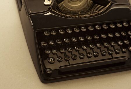 View of an antique manual Underwood typewriter in sepia color