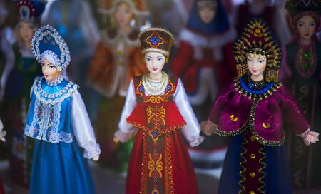 Beautiful vintage colourful wooden dymkovo dolls at market. Dymkovo dolls is folks cultural symbol of Russia. With selective focus on one doll 版權商用圖片