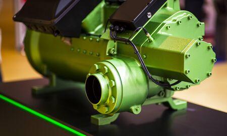 Industrial machinery of blue hydraulic pump, blur background