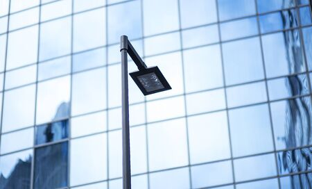 Poles led. Street light against the blue sky with clouds. copy space. 版權商用圖片