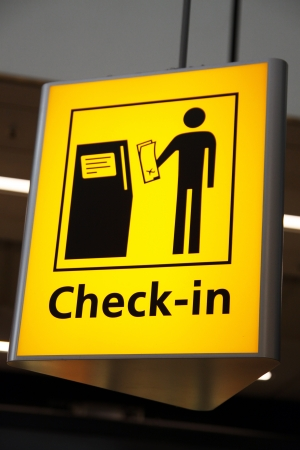 Airport sign - Check-in sign at shiphol Amsterdam photo
