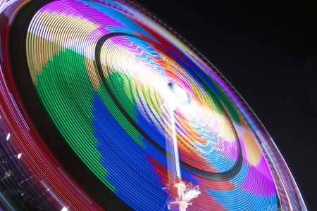 Multi Magic colored spinning wheel, image for wallpaper  Photo taken at the fun fair of Hoorn the netherlands   photo