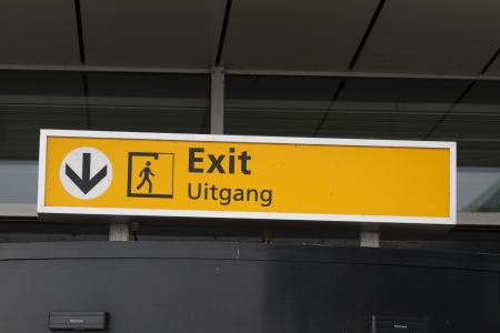 arrivals: Yellow information exit sign