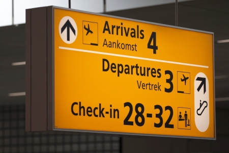 arrivals: Airport Arrivals and departure information sign