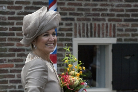 orange nassau: Queen Maxima of the Netherlands with flowers during a official introductory visit to the city of Enkhuizen on June 19 2013 in Enkhuizen, Netherlands