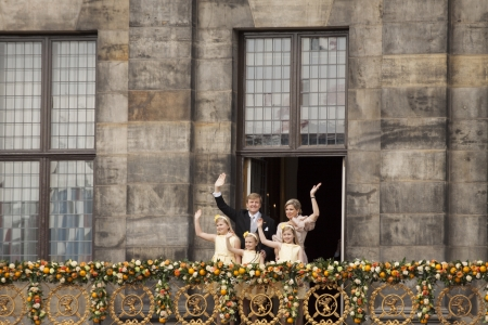AMSTERDAM - APR 30  King Willem-Alexander, Queen Maxima and children waves from the balcony of the palace after the accession of the throne on April 30, 2013 in Amsterdam   Stock Photo - 23342916