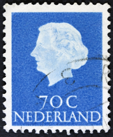 estampilla: NETHERLANDS - CIRCA 1953  A stamp printed in the Netherlands shows Queen Juliana, circa 1953  Was Queen of Netherlands in the period September 4, 1948 to April 30, 1980
