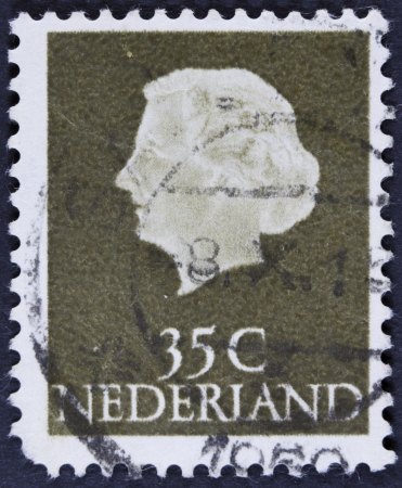 orange nassau: NETHERLANDS - CIRCA 1953  A stamp printed in the Netherlands shows Queen Juliana, circa 1953  Was Queen of Netherlands in the period September 4, 1948 to April 30, 1980