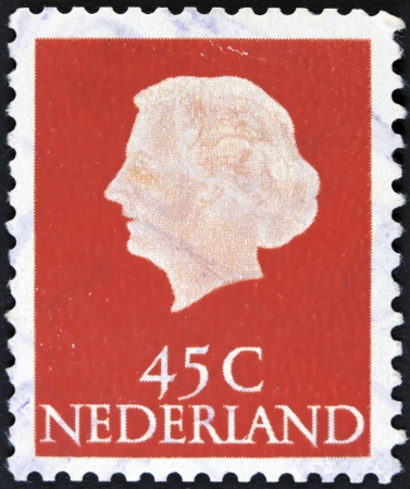 NETHERLANDS - CIRCA 1953  A stamp printed in the Netherlands shows Queen Juliana, circa 1953  Was Queen of Netherlands in the period September 4, 1948 to April 30, 1980   photo