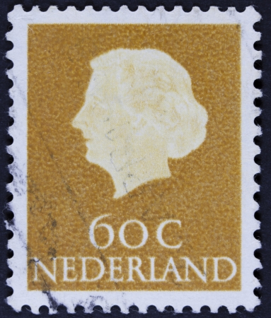 nederlan: NETHERLANDS - CIRCA 1953  A stamp printed in the Netherlands shows Queen Juliana, circa 1953  Was Queen of Netherlands in the period September 4, 1948 to April 30, 1980