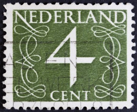 NETHERLANDS - CIRCA 1946  A stamp printed in the Netherlands showing it s value of 4 cent, circa 1946