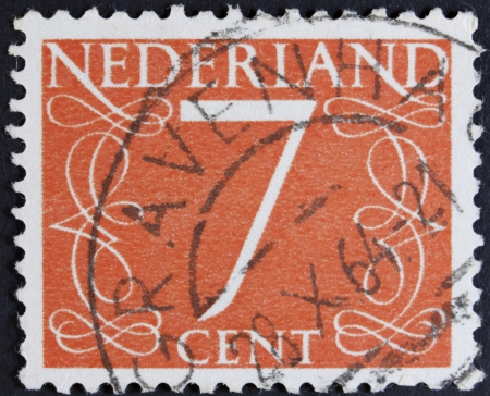 NETHERLANDS - CIRCA 1946  A stamp printed in the Netherlands showing it s value of 7 cent, circa 1946
