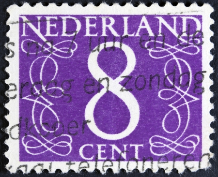 NETHERLANDS - CIRCA 1946  A stamp printed in the Netherlands showing it s value of 8 cent, circa 1946