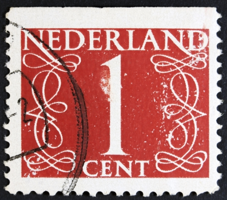 NETHERLANDS - CIRCA 1946  A stamp printed in the Netherlands showing it s value of 1 cent, circa 1946   Stok Fotoğraf